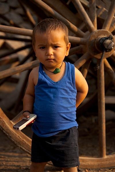 101218_indian_boy_holding_mobile_cell_phone_businessman_bijapur_karnataka_india_IMG_9170