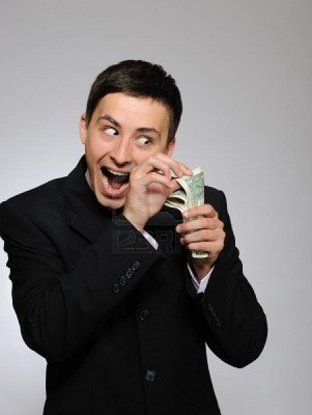 8123337-expressions--young-handsome-business-man-in-black-suit-and-tie-counting-money-gray-background