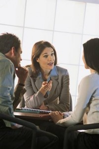 Business-Woman-in-meeting-200x300