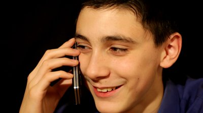 stock-footage-boy-mobile-phone