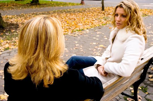 two-women-talking-on-bench