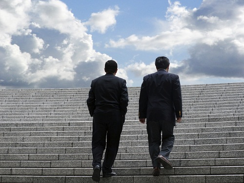 Two-men-walking-up-stone-steps-to-sky